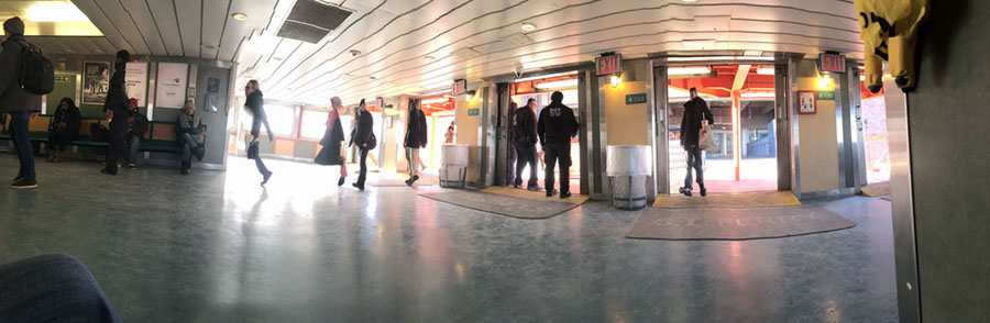 people getting onto the Staten island Ferry