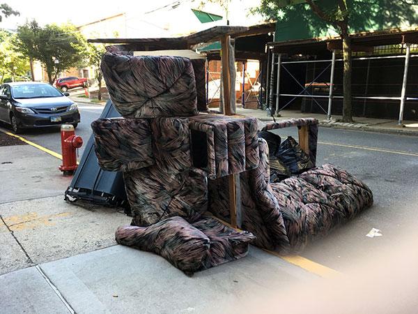 Sofa put out on the sidewalk