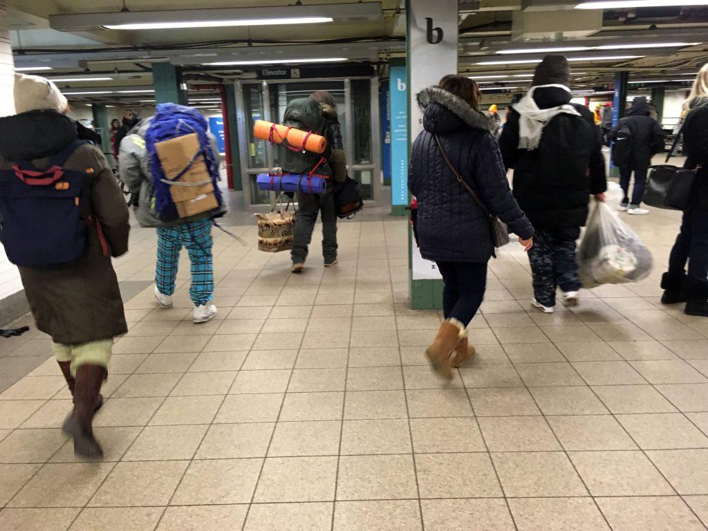 People at 14th Street subway station, NYC
