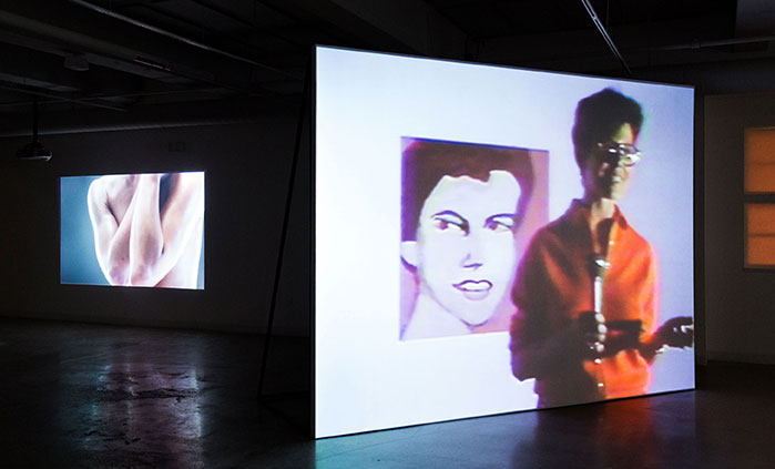video still, gallery installation, Gay Tape: Butch and Femme by Cecilia Dougherty, 1985